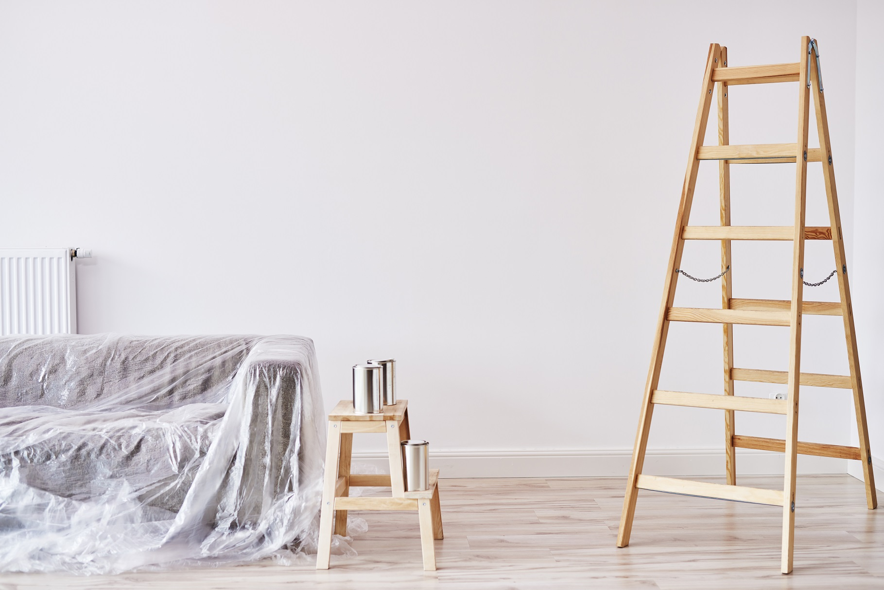 home maintenance with ladder and paint