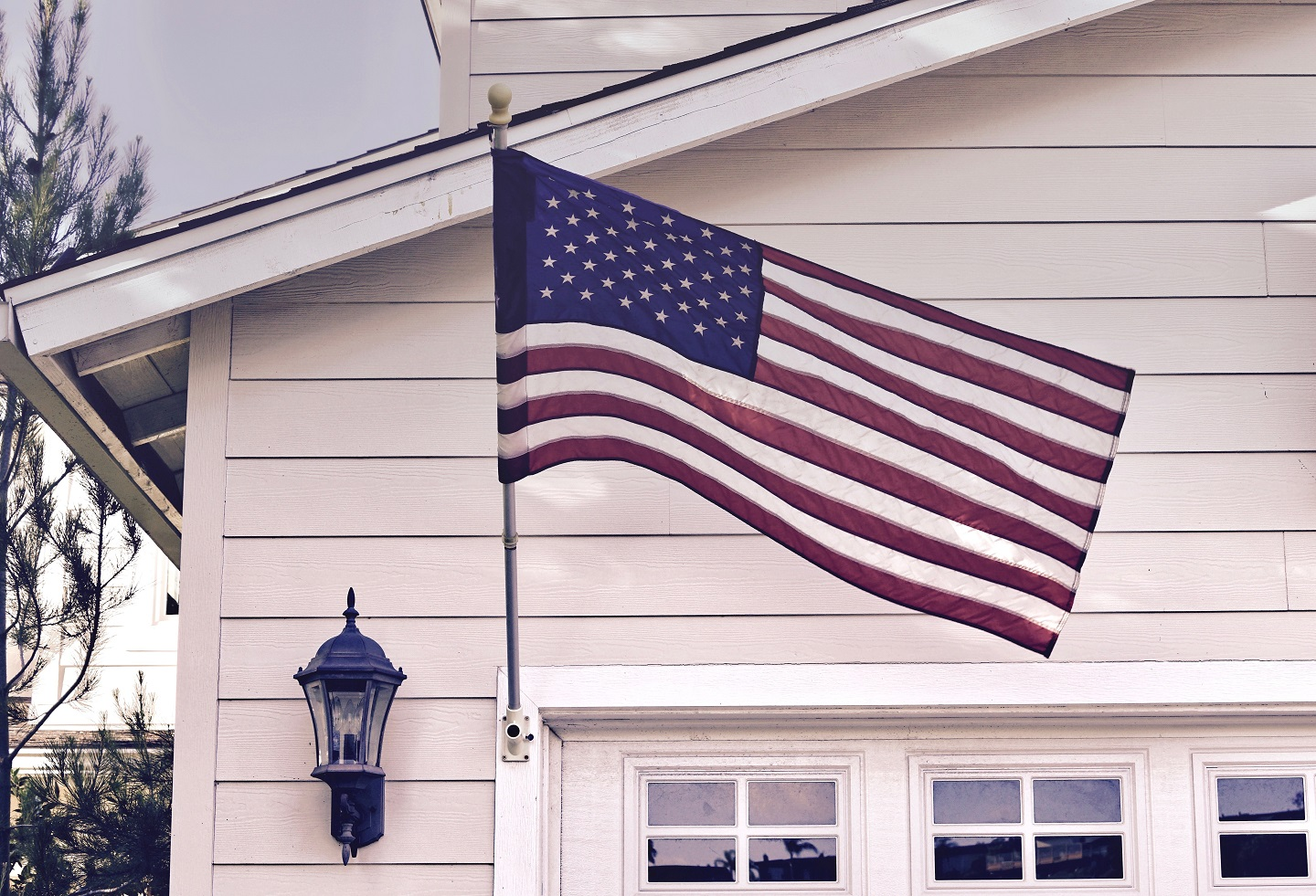 home in colorado springs with an american flag
